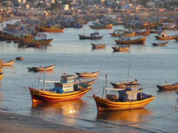 Fishing boats at sunset, Mui Ne