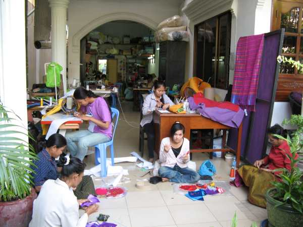 Young women sewing in work area attached to Le Rits hotel and restaurant