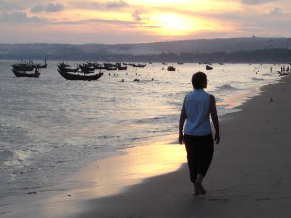 Strolling at sunset on Mui Ne Beach